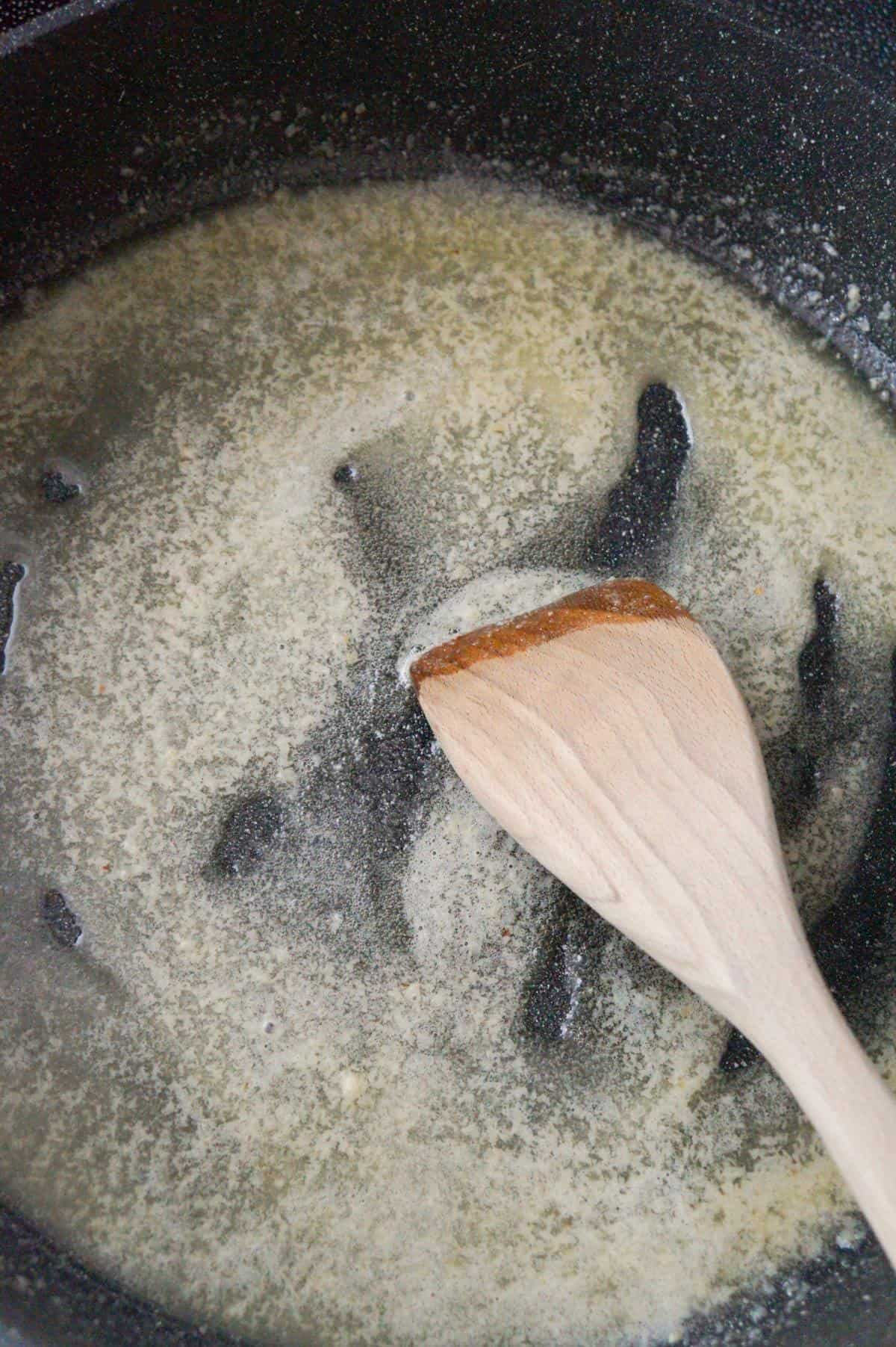 garlic puree and melted butter in a large pan