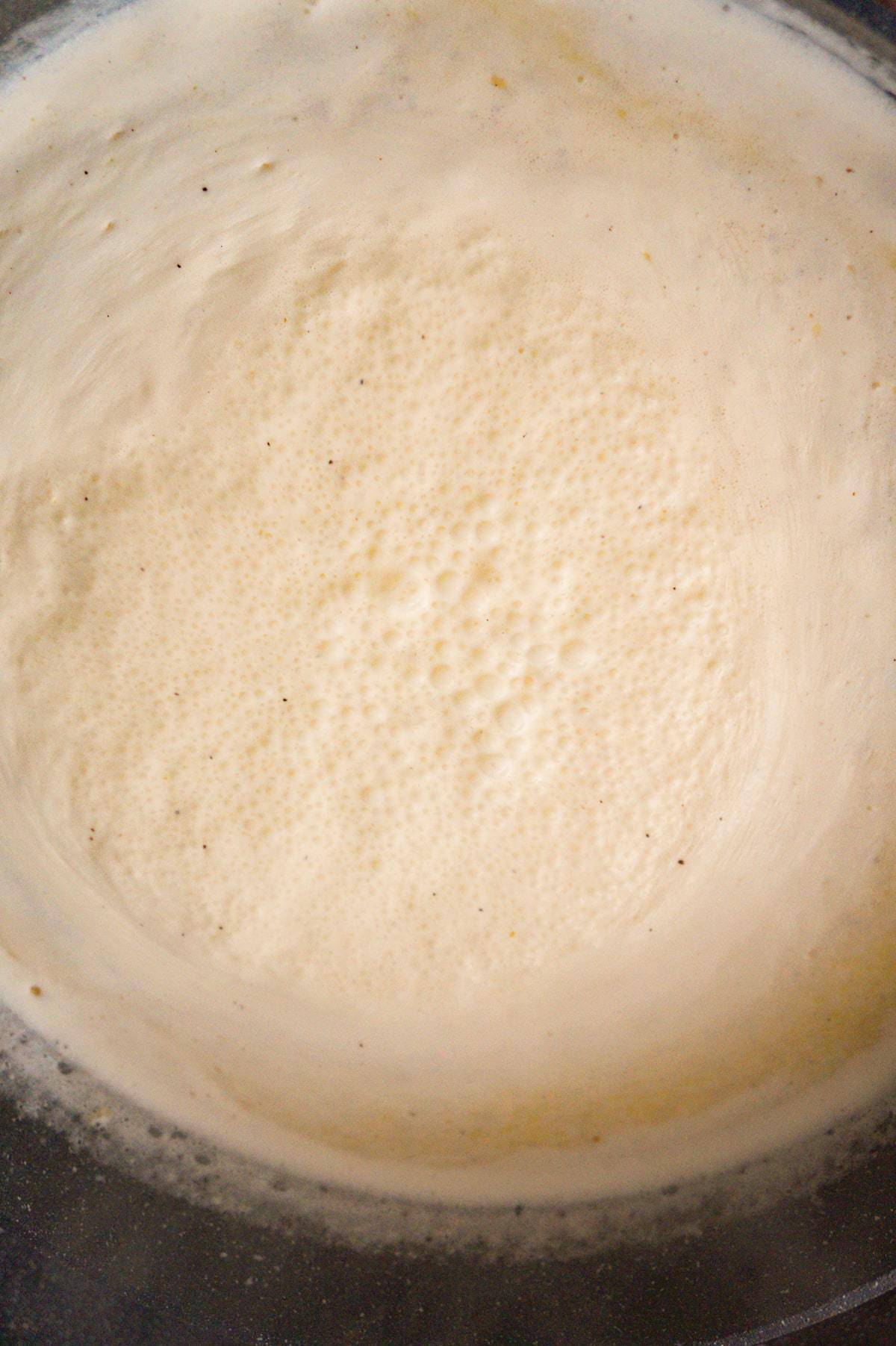 cream sauce cooking in a large pan