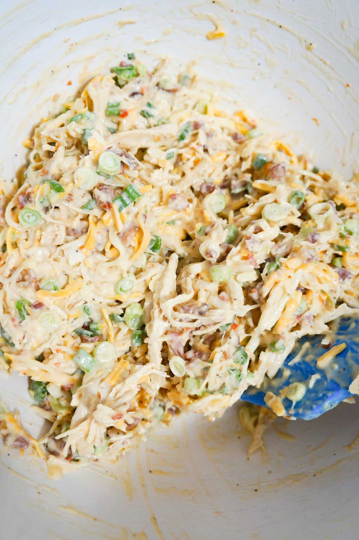 sweet chili bacon chicken salad in a mixing bowl