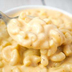 Instant Pot Extra Creamy Mac and Cheese is a simple and delicious pressure cooker pasta recipe made with cheddar cheese soup, heavy cream, mozzarella and cheddar cheese.