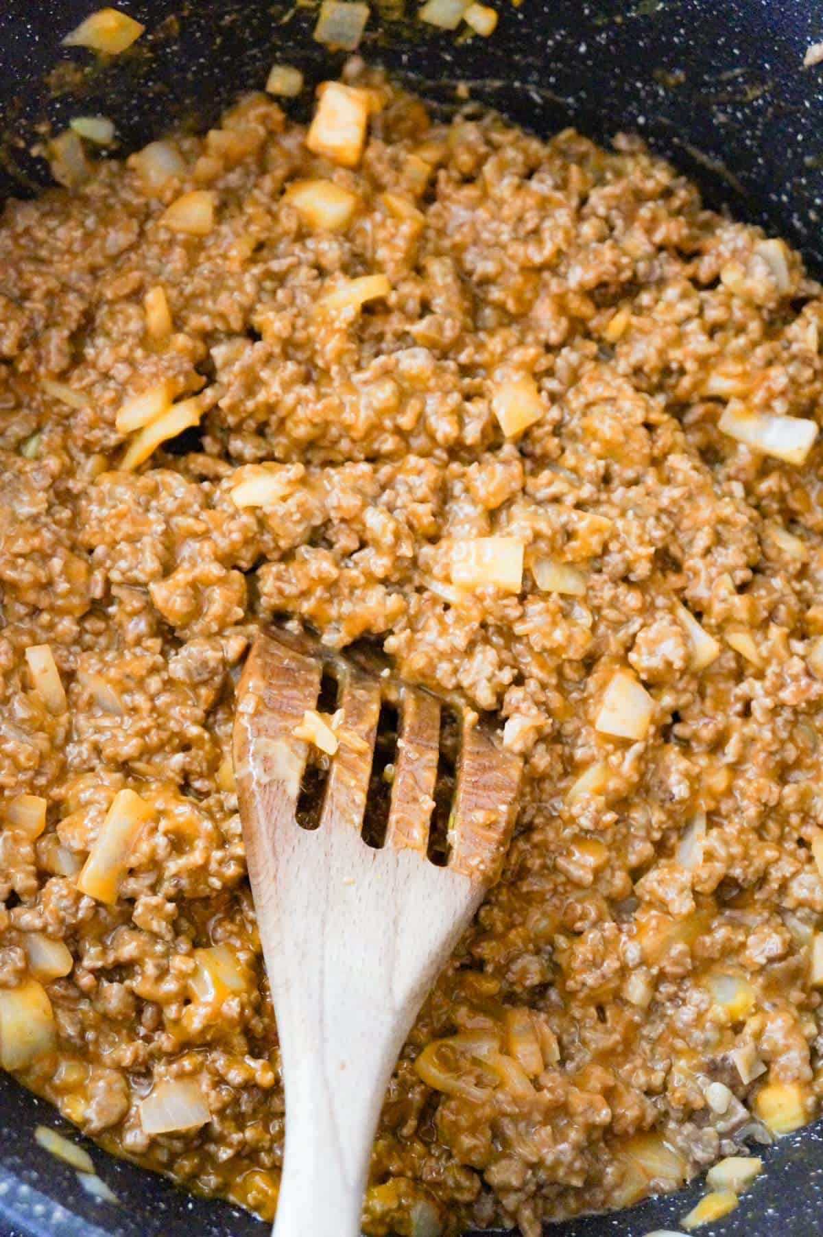 ground beef and cheese soup mixture in a saute pan