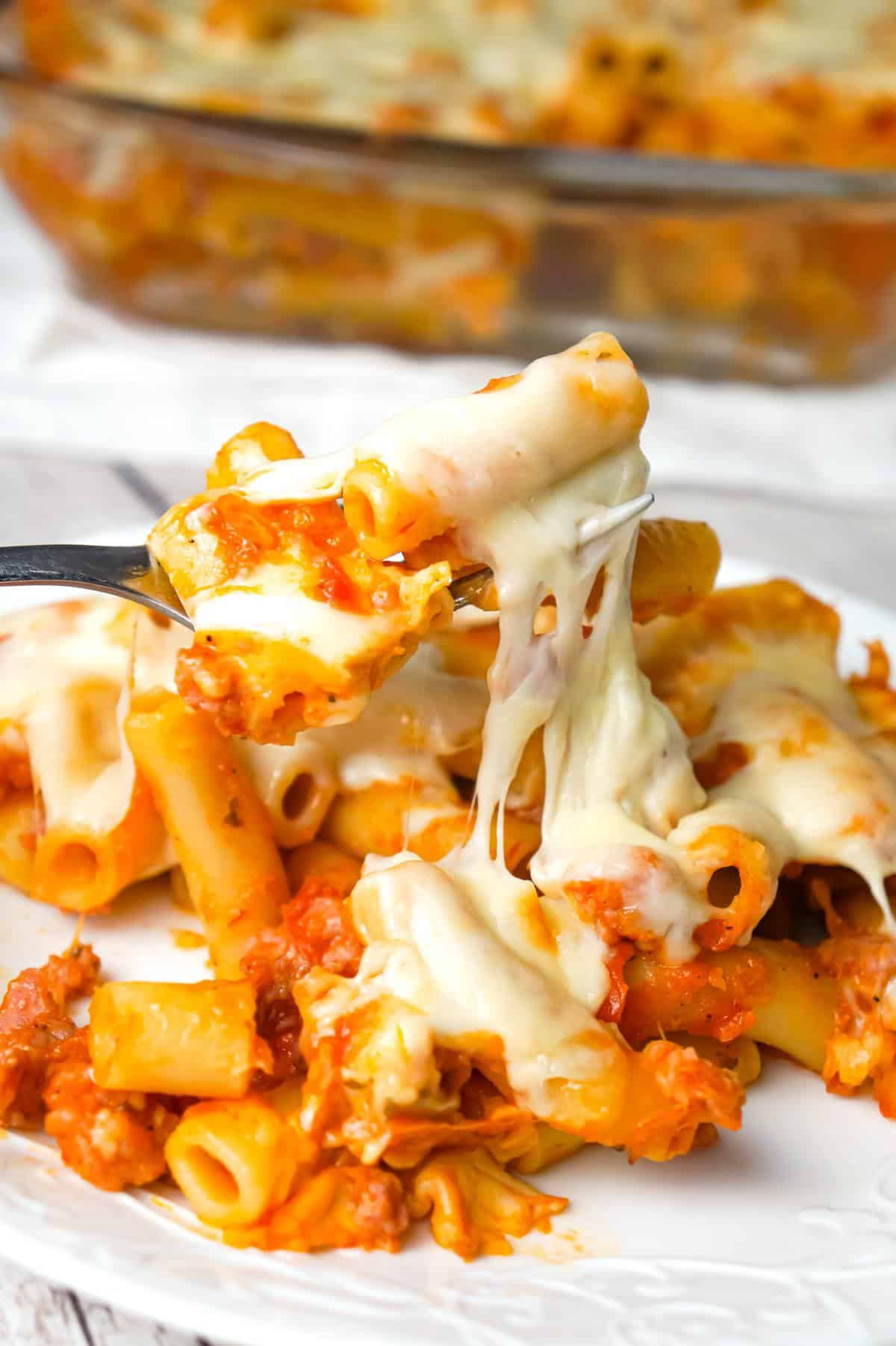 Baked Ziti with Sausage is an easy pasta recipe loaded with crumbled Italian sausage meat, marinara sauce, chunks of string cheese and shredded mozzarella.