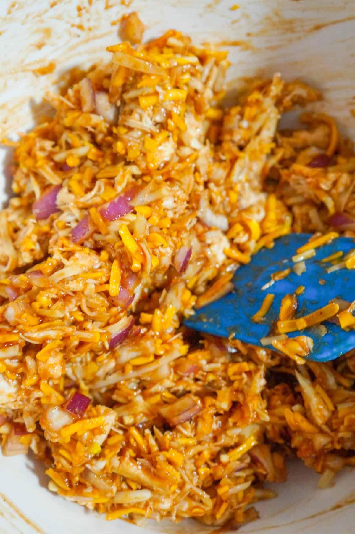 shredded bbq chicken mixture in a mixing bowl