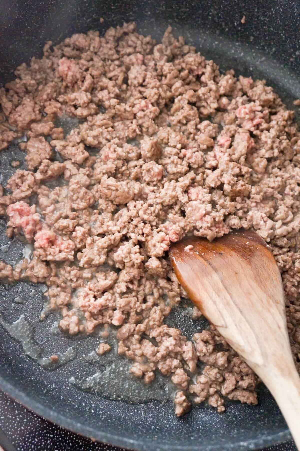 ground beef cooking in a saute pan