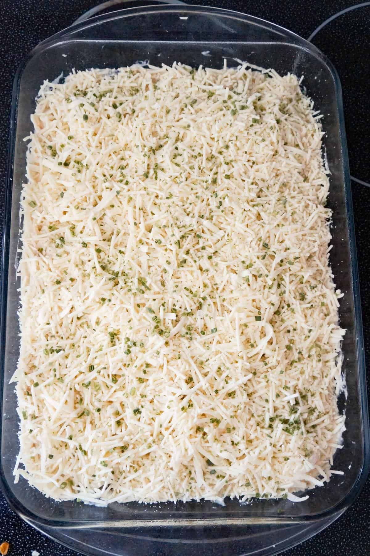 chopped chives, shredded Parmesan and shredded Mozzarella on top of chicken spaghetti before baking