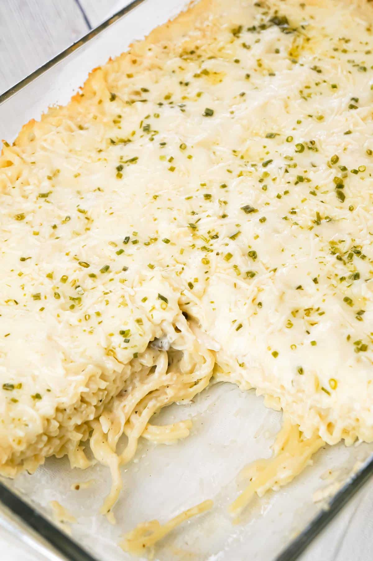 Chicken Tetrazzini is a creamy baked pasta dish loaded with shredded chicken, Parmesan and Mozzarella cheese.
