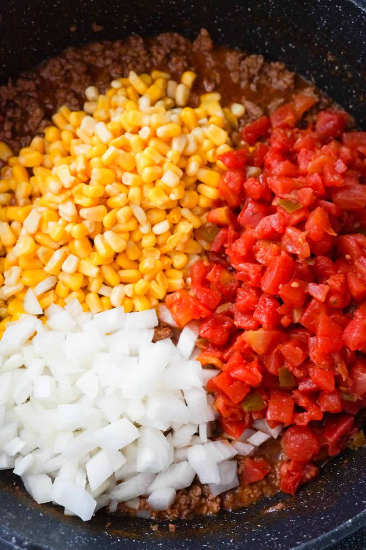diced onions, Rotel, corn and ground beef in a large saute pan