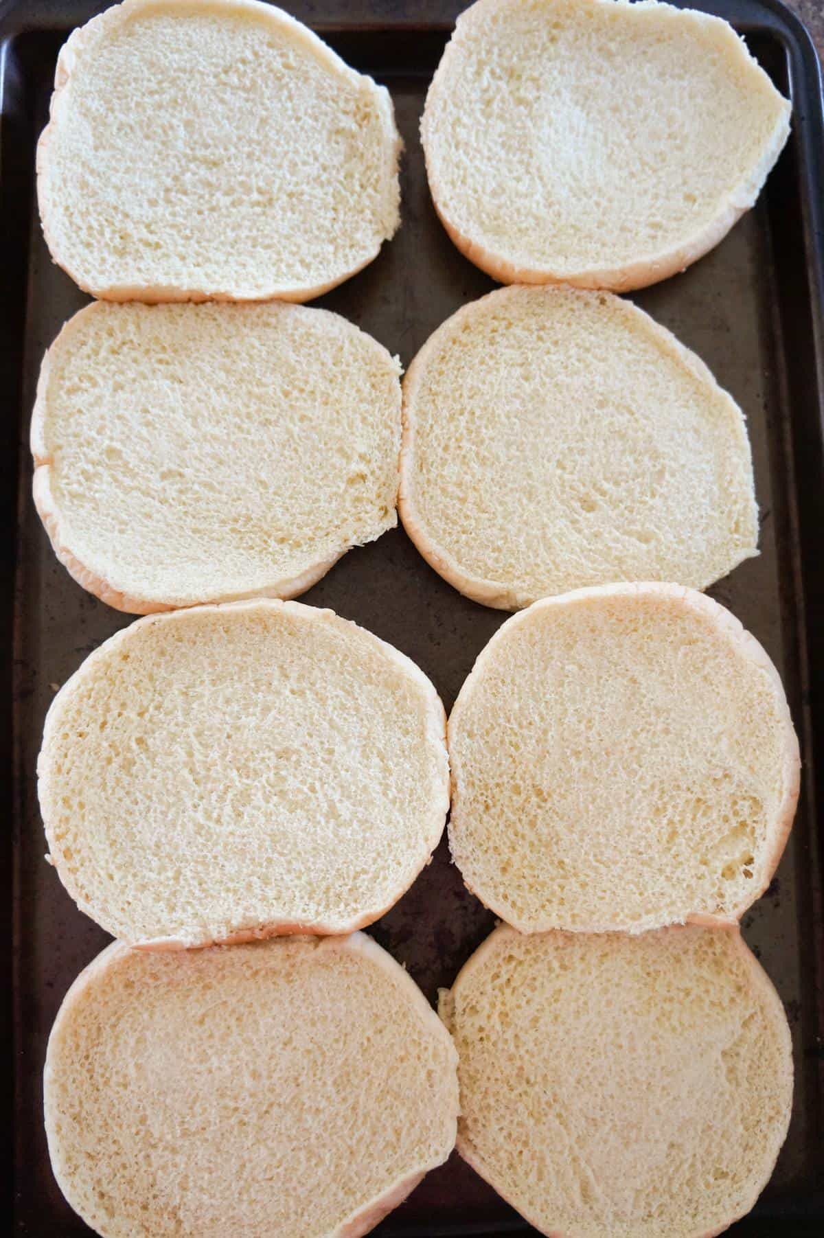 hamburger buns on a baking sheet
