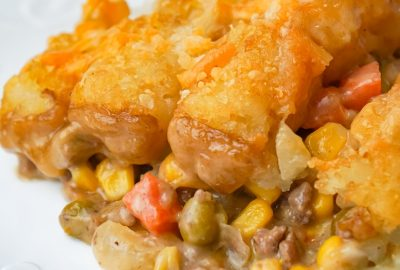 Tater Tot Hotdish is an easy ground beef casserole recipe loaded with canned veggies, cream of mushroom soup, cheddar cheese and topped with tater tots.