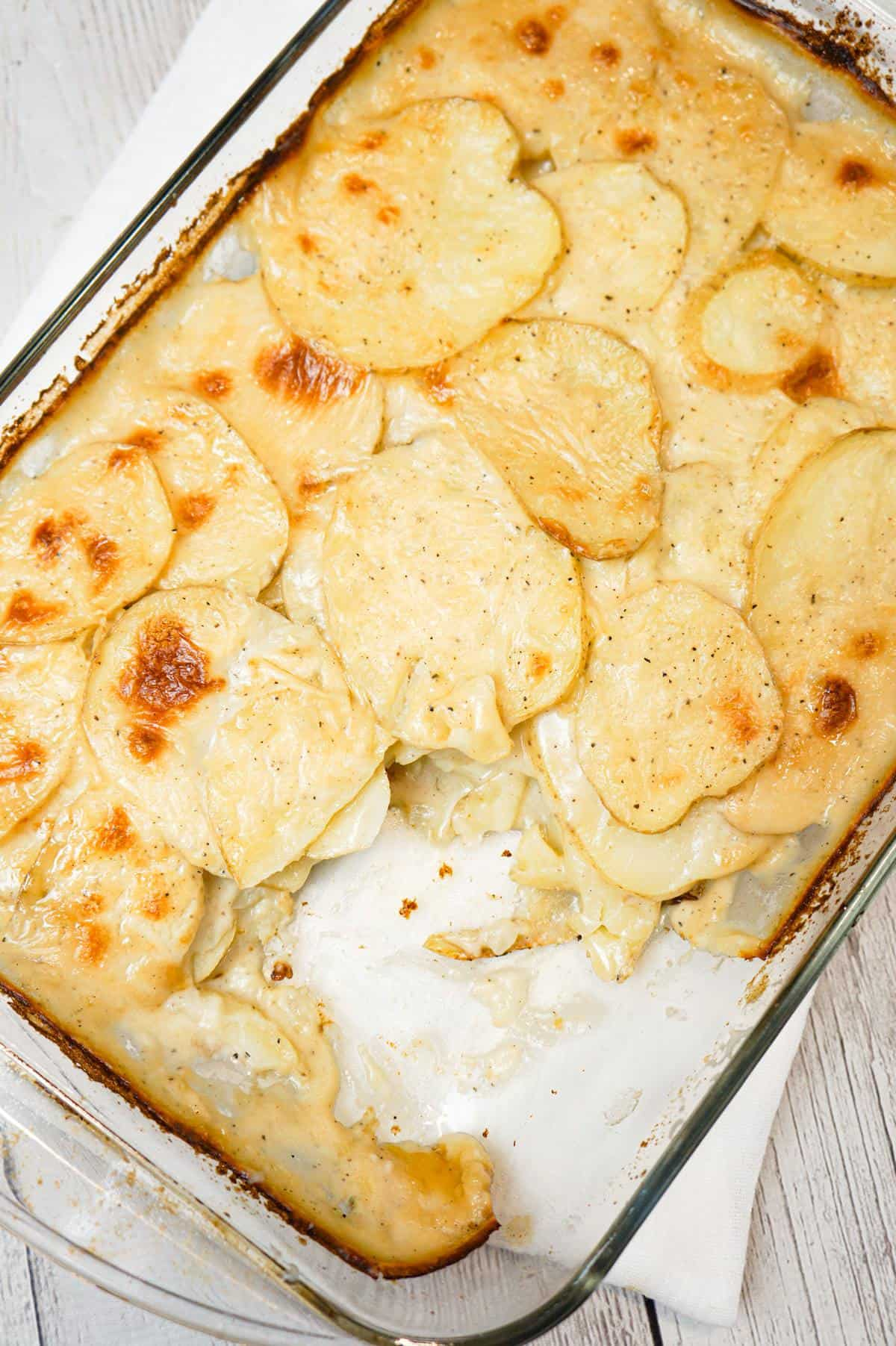 Scalloped Potatoes are a delicious side dish recipe made with thinly sliced potatoes layered with a creamy onion sauce and baked in the oven.
