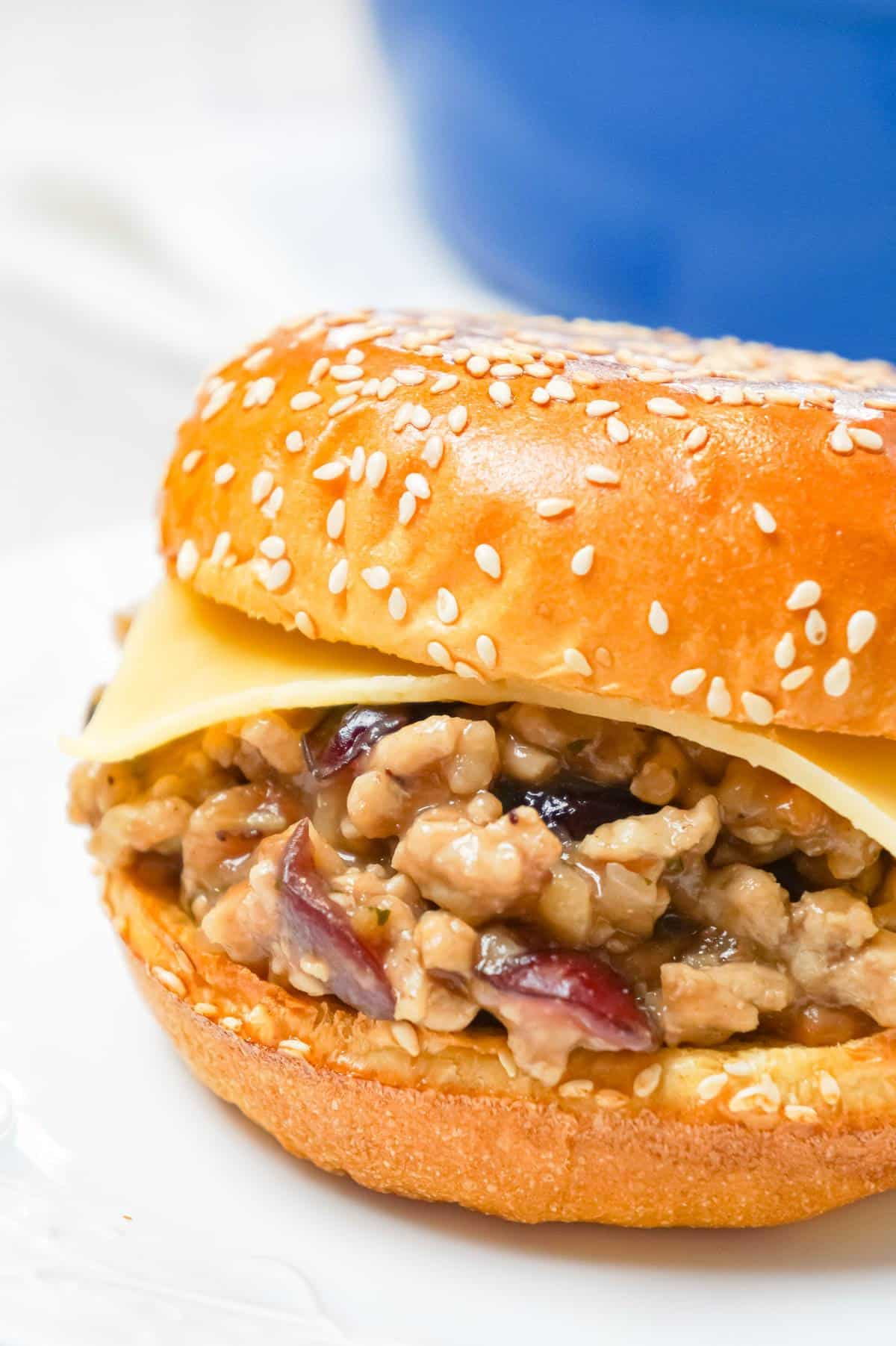 Turkey Dinner Sloppy Joes are an easy weeknight dinner recipe made with ground turkey and loaded with gravy, stove top stuffing mix, cranberry sauce and Havarti cheese all on served on Brioche buns.