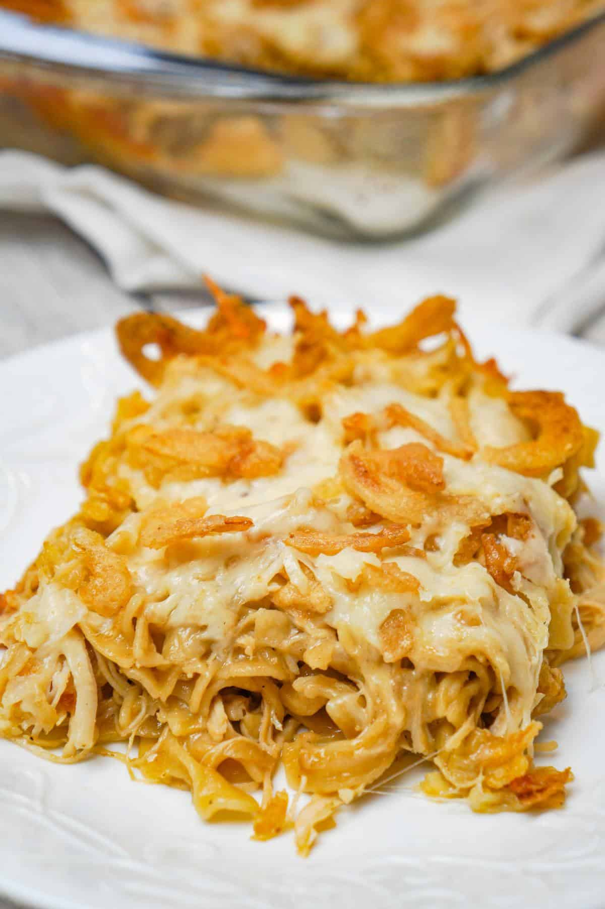 French Onion Chicken Casserole is a hearty casserole recipe loaded with shredded chicken, egg noodles, onion soup mix, cream of chicken soup, mozzarella cheese, parmesan cheese and French's crispy fried onions.