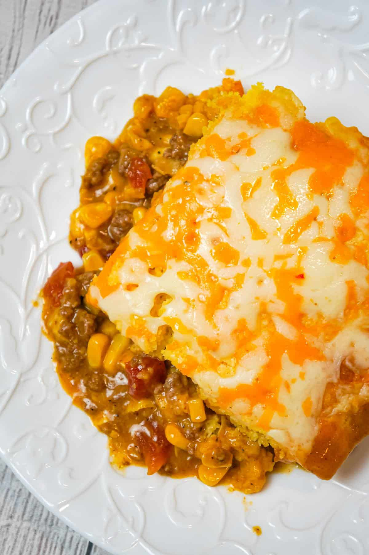 Mexican Cornbread Casserole is an easy ground beef dinner recipe loaded with corn, Rotel diced tomatoes and green chilies, taco seasoning and shredded cheese all topped with Jiffy cornbread.