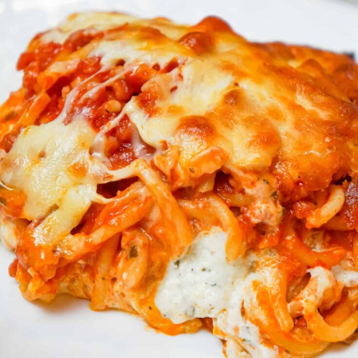 Million Dollar Spaghetti is a delicious baked spaghetti recipe loaded with Italian sausage, cream cheese, sour cream and a blend of shredded Italian cheeses.