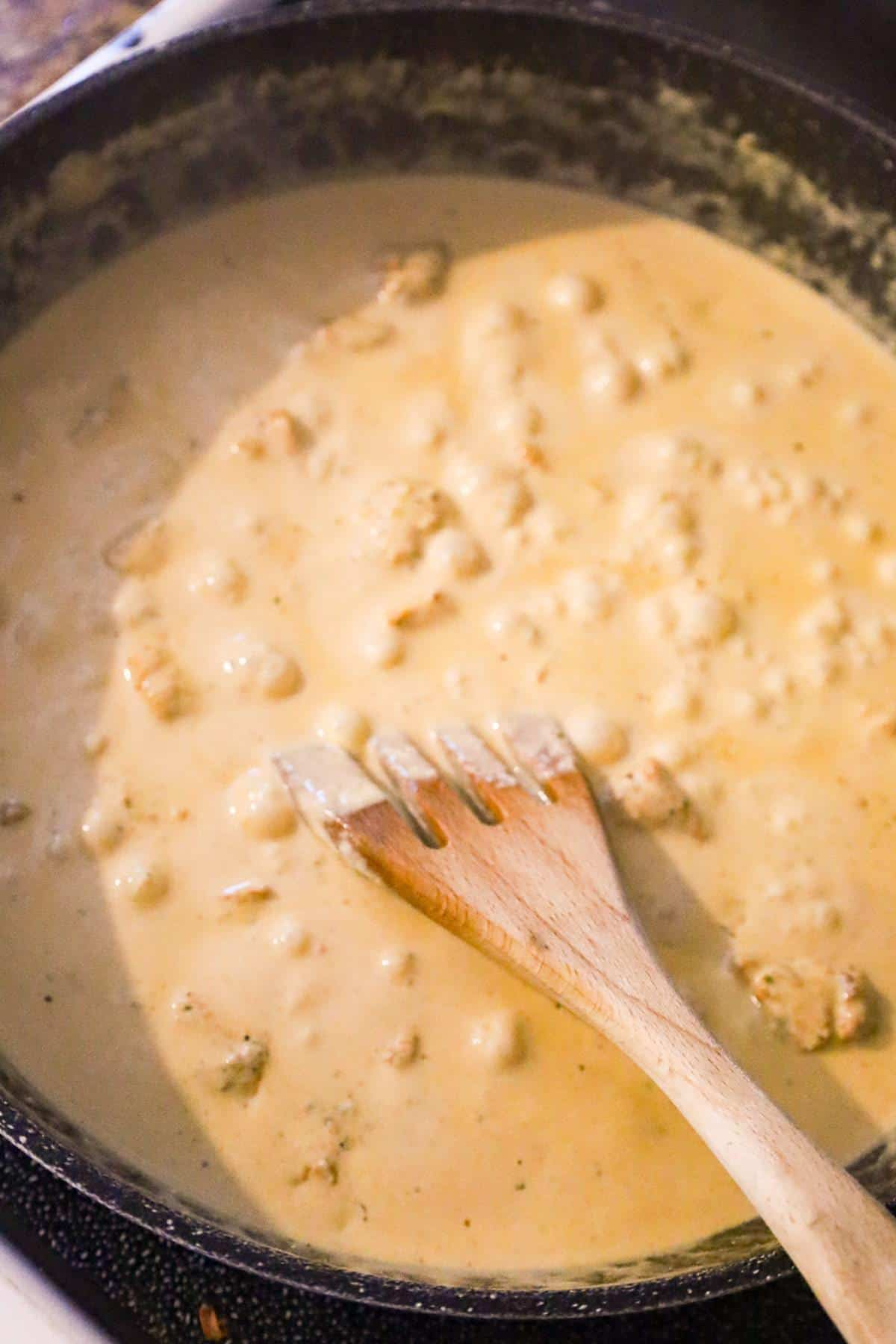 creamy cajun sauce cooking in a saute pan