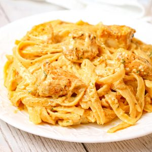 Cajun Chicken Alfredo is a creamy pasta recipe loaded with chunks of chicken breast, Cajun seasoning and parmesan cheese.