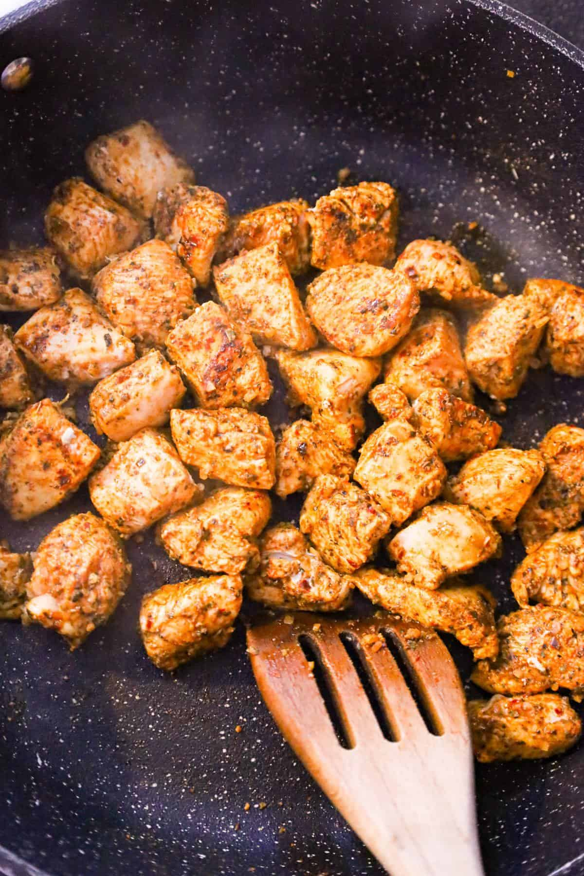 cajun chicken chunks cooking in a saute pan