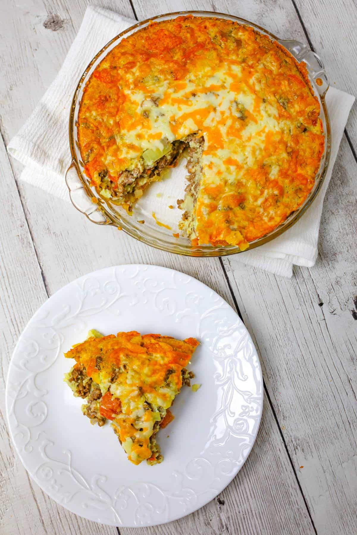 Cheeseburger Pie with Bisquick is an easy ground beef dinner recipe loaded with shredded cheese, diced onions and diced tomatoes.