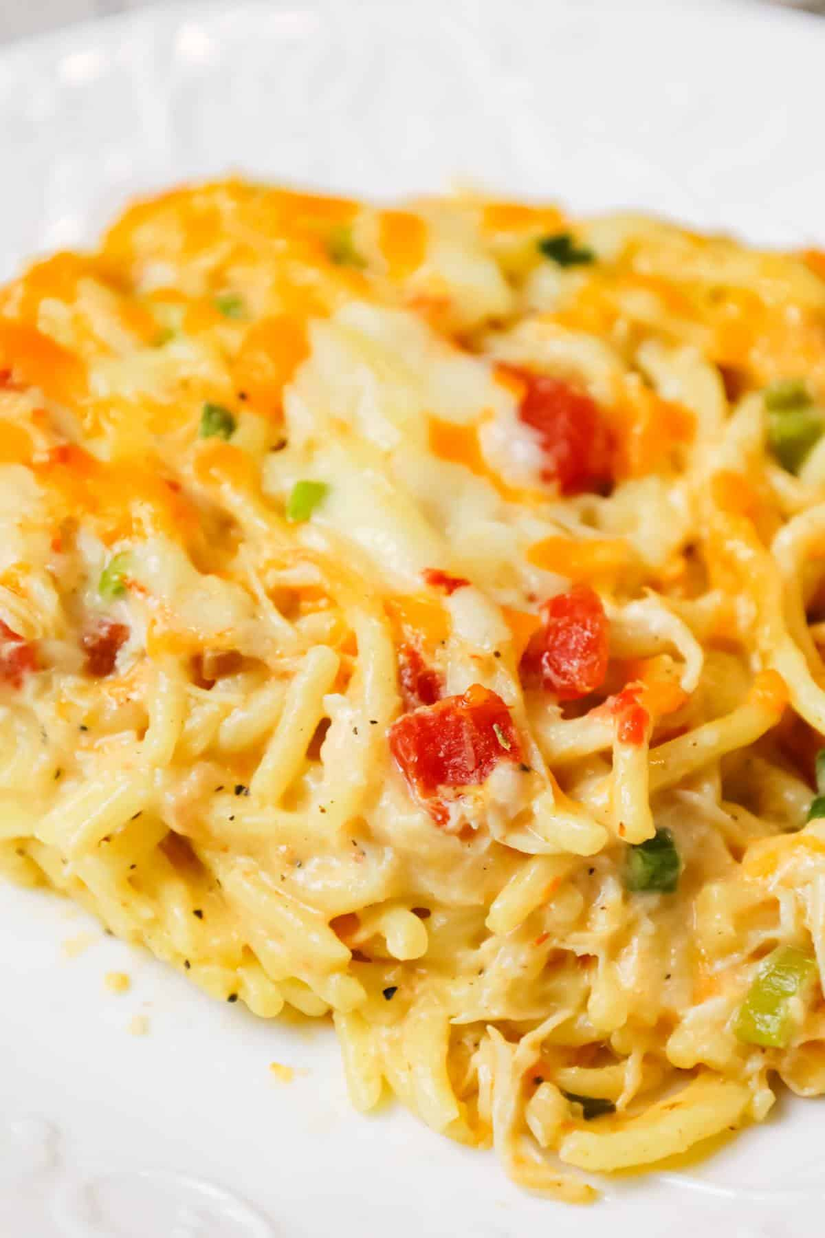 Chicken Spaghetti with Rotel is a delicious baked spaghetti recipe with a creamy sauce loaded with shredded chicken, Rotel diced tomatoes and green chilies, shredded cheese and chopped green onions.