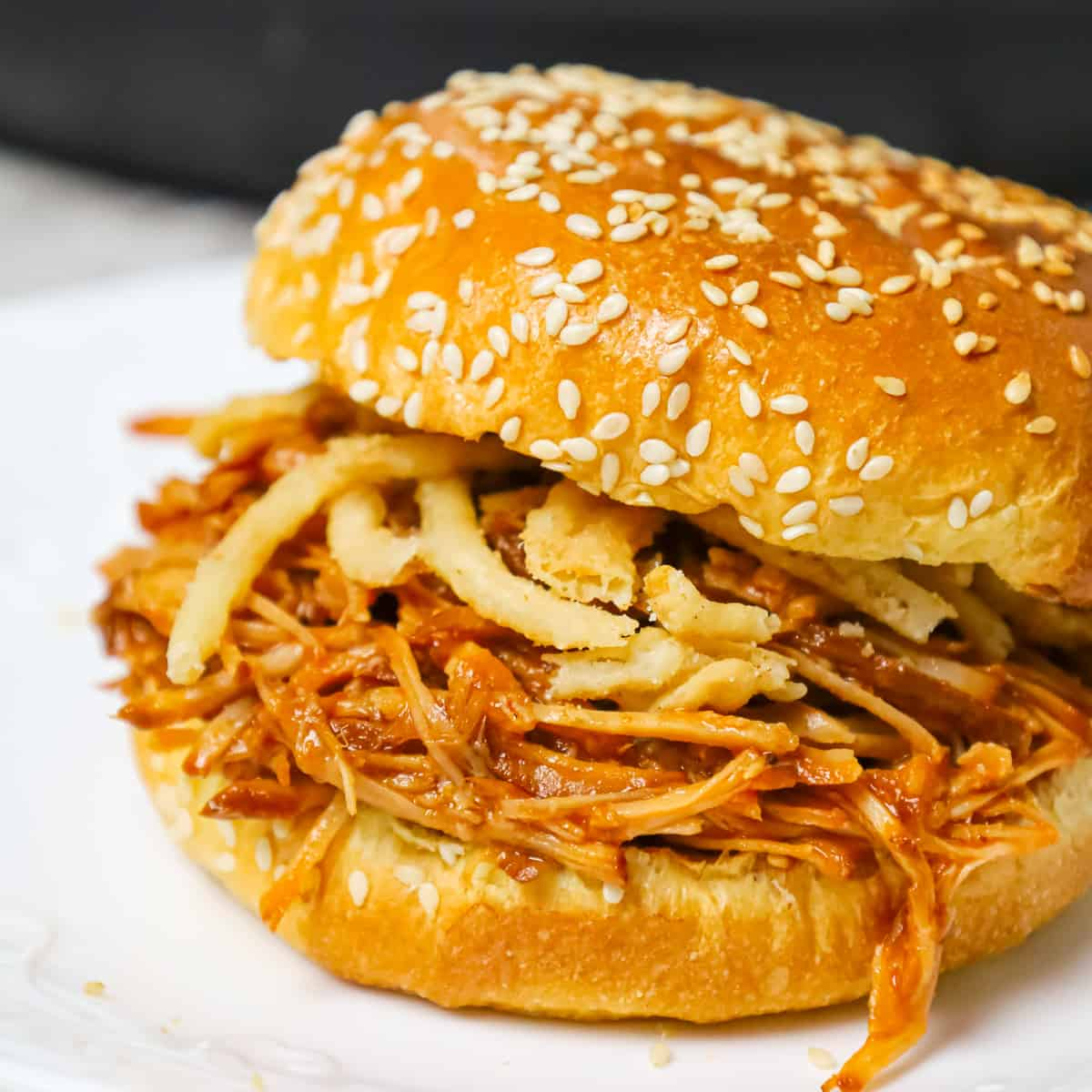 Instant Pot Pulled Pork is an easy and delicious dinner made with a boneless pork roast pressure cooked in apple juice and BBQ sauce.