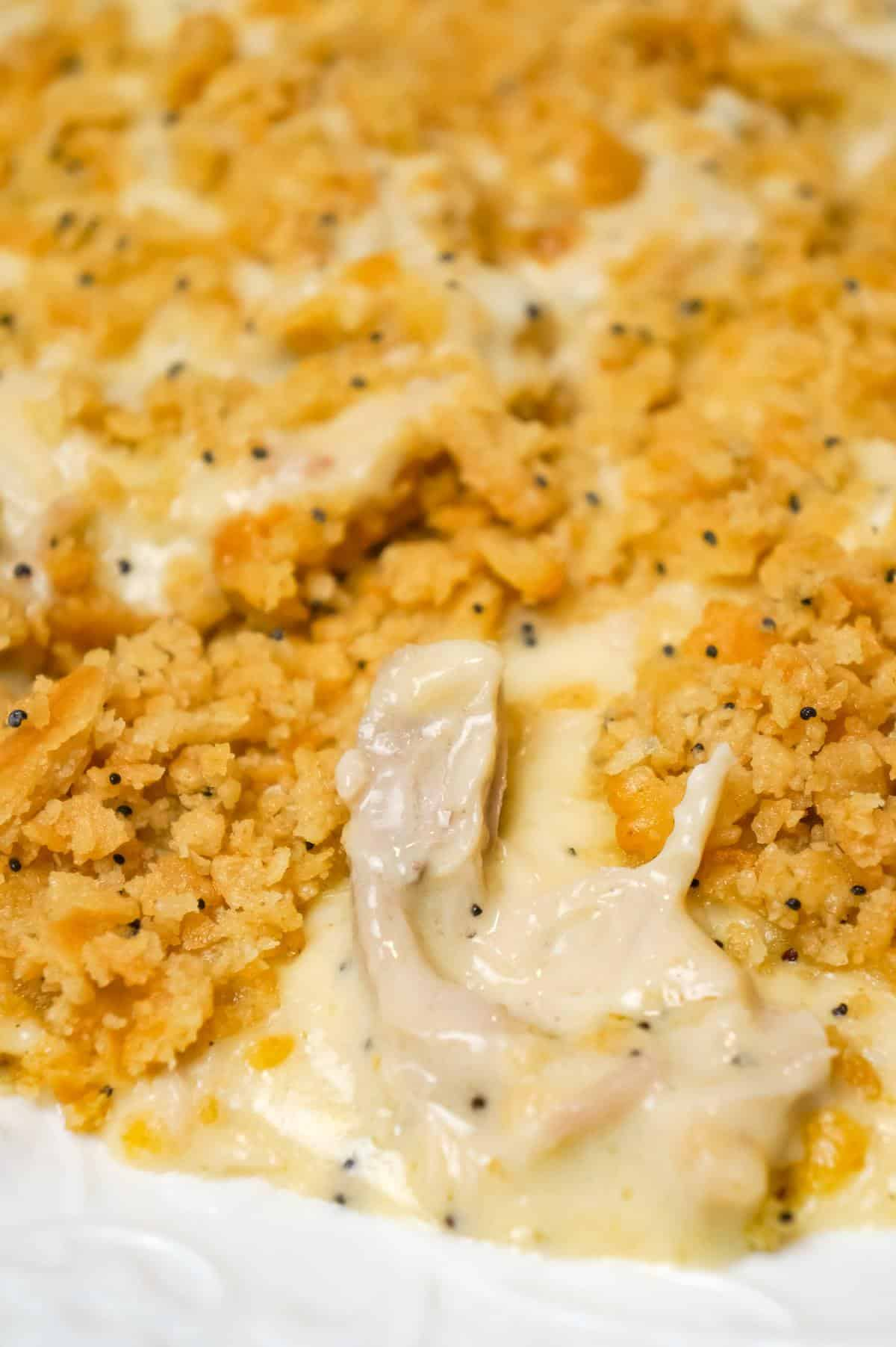 Poppy Seed Chicken Casserole is an easy dinner recipe loaded with shredded chicken, cream of chicken soup, shredded cheese and poppy seeds and topped with crumbled Ritz crackers.