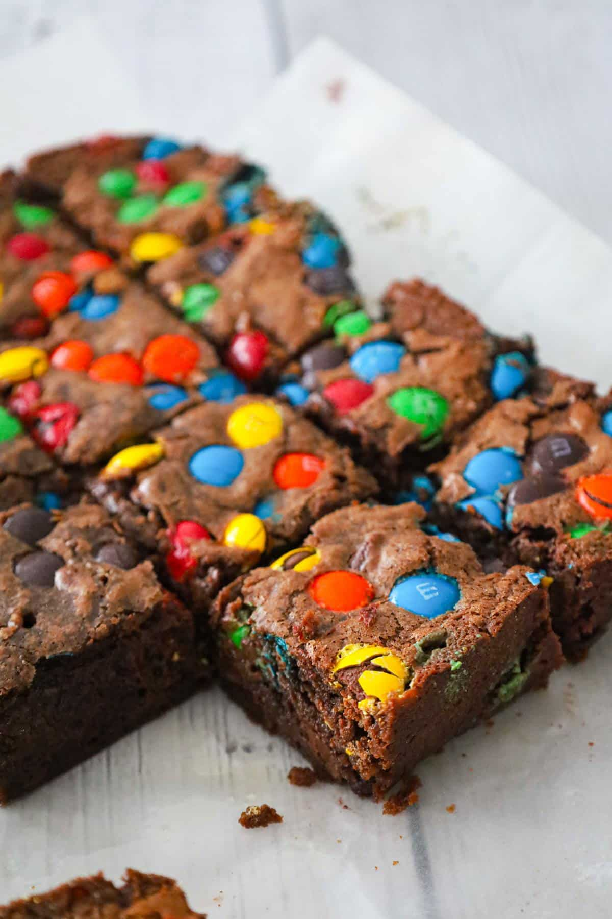 M&M Brownies are delicious fudgy brownies loaded with semi sweet chocolate chips and M&M's candies.