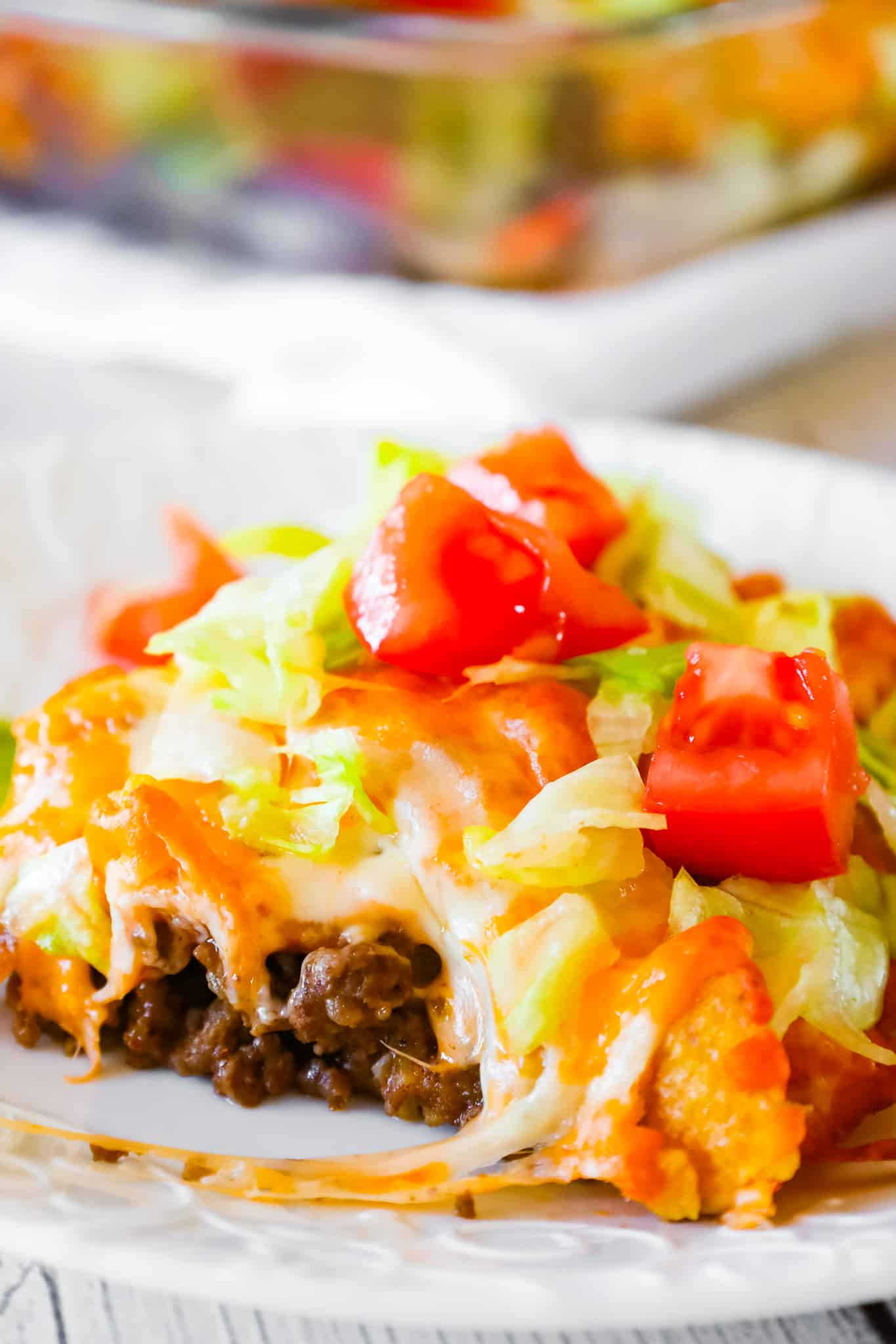 Walking Taco Casserole is an easy ground beef dinner recipe loaded with diced onions, Fritos corn chips, shredded nacho cheese blend, lettuce and diced tomatoes.