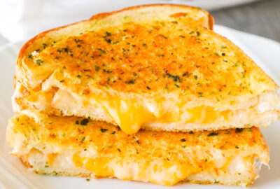 Garlic Bread Grilled Cheese is an easy lunch or dinner recipe with garlic buttered bread filled with gooey mozzarella and cheddar cheese.