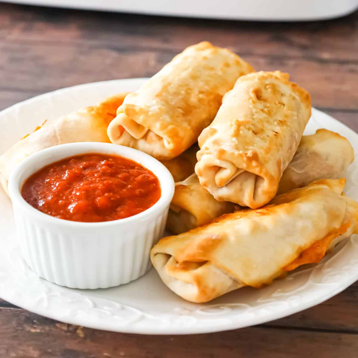 Air Fryer Pizza Rolls are an easy dinner or party food recipe using egg roll wrappers stuffed with diced pepperoni, mozzarella cheese and pizza sauce.