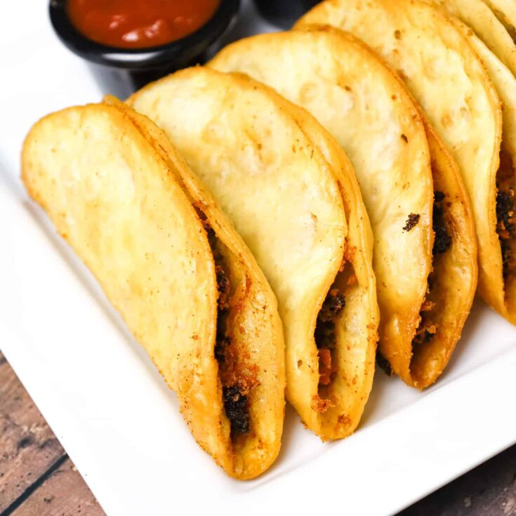 Fried Tacos are an easy ground beef dinner recipe using flour tortillas filled with taco beef and shredded cheese before frying.