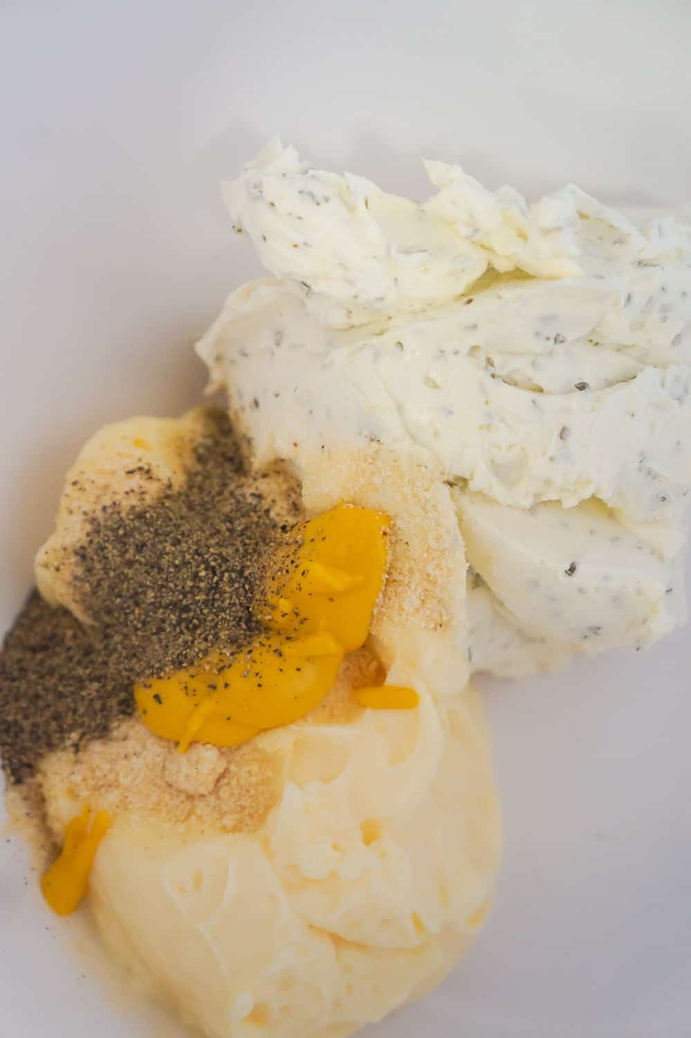 herb and garlic cream cheese, mayo and mustard in a mixing bowl