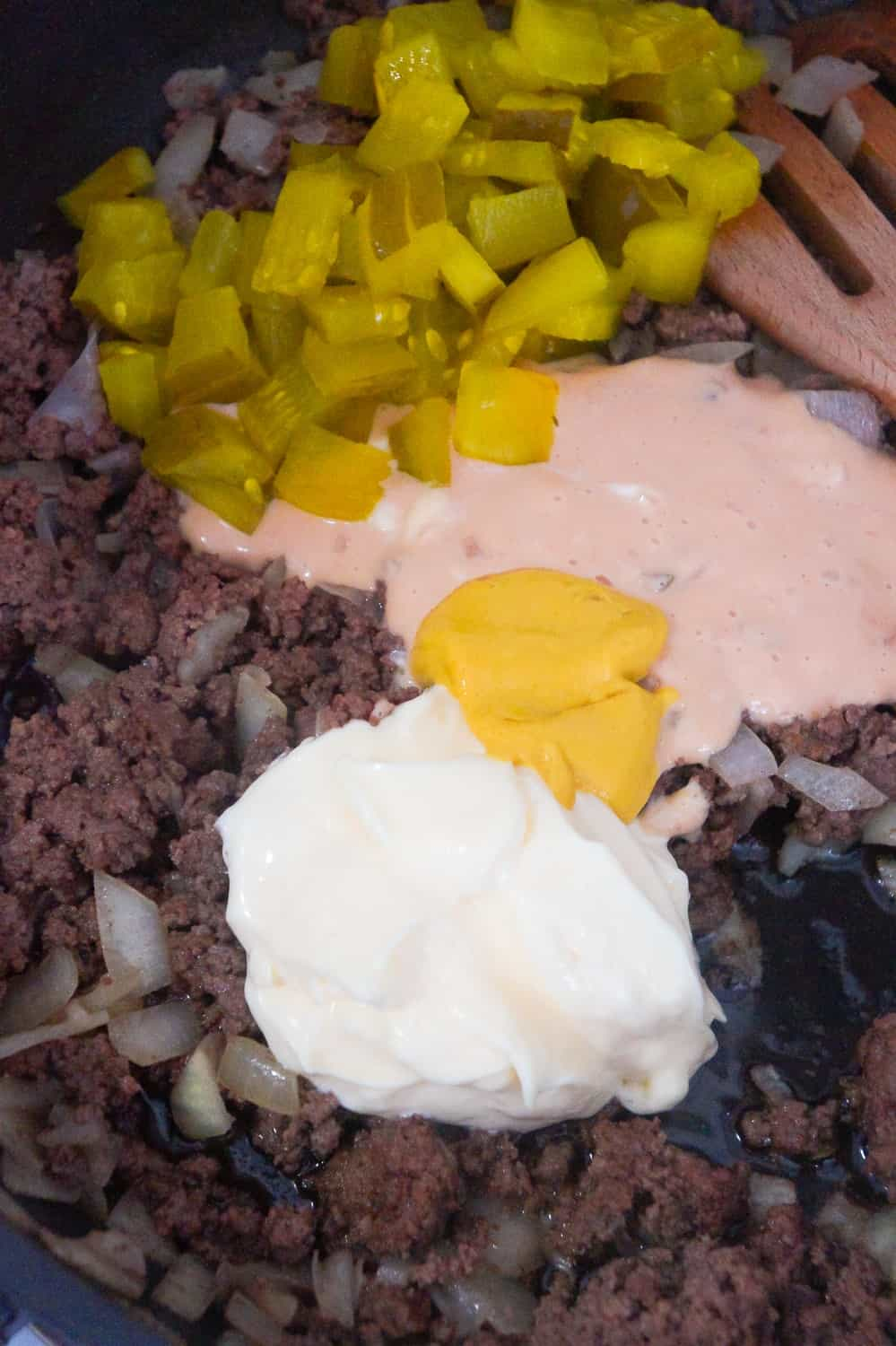 mayo, Thousand Islands dressing, mustard and diced dill pickles added to cooked ground beef