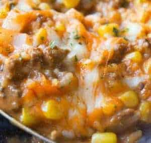 Ground Beef Recipes. Cheesy Tomato Ground Beef and Rice is an easy stove top dinner recipe packed with flavour. This ground beef dish is made with cream of tomato soup, canned corn, instant rice and loaded with cheddar cheese.