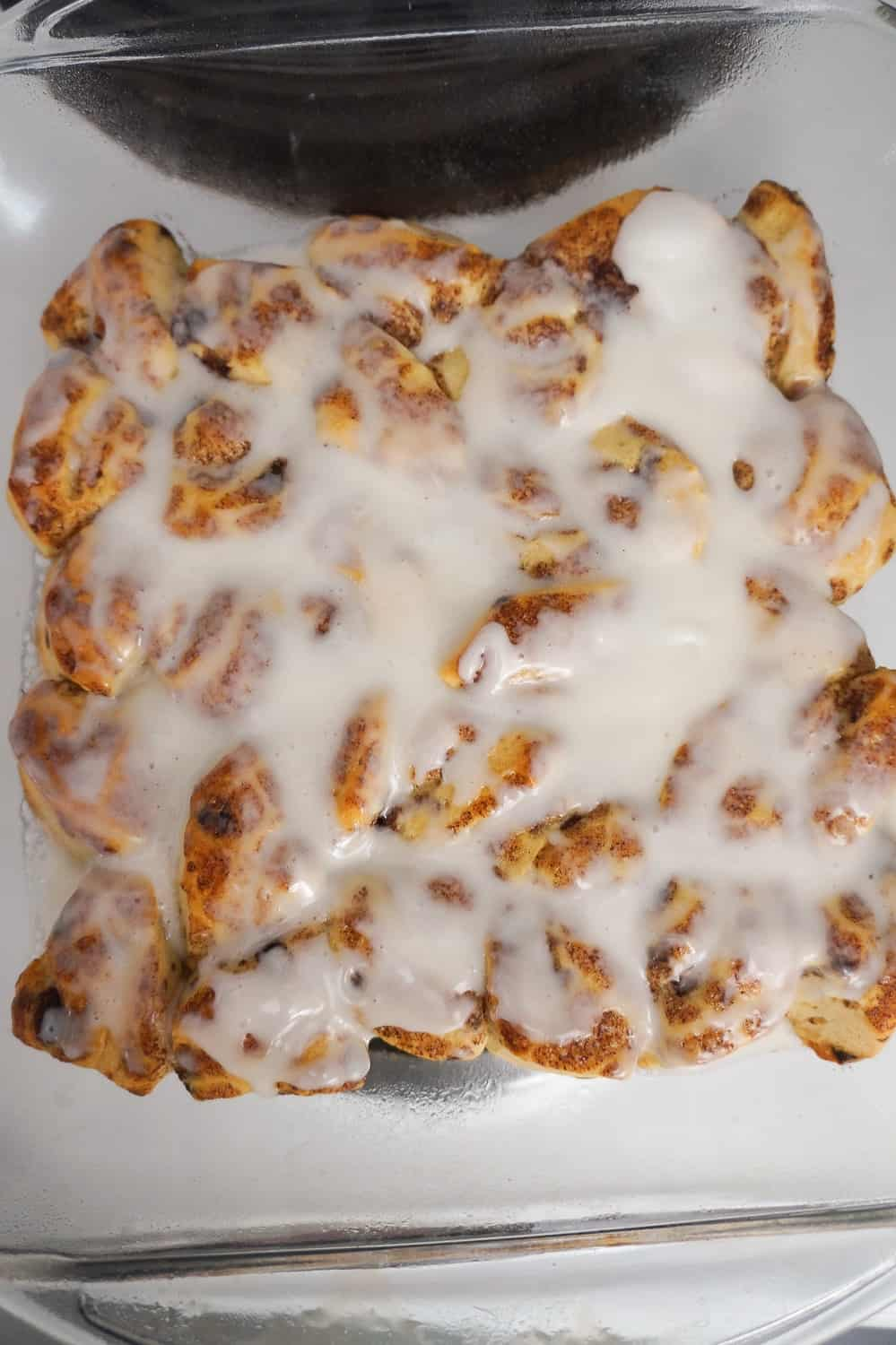 baked cinnamon bun pieces with icing