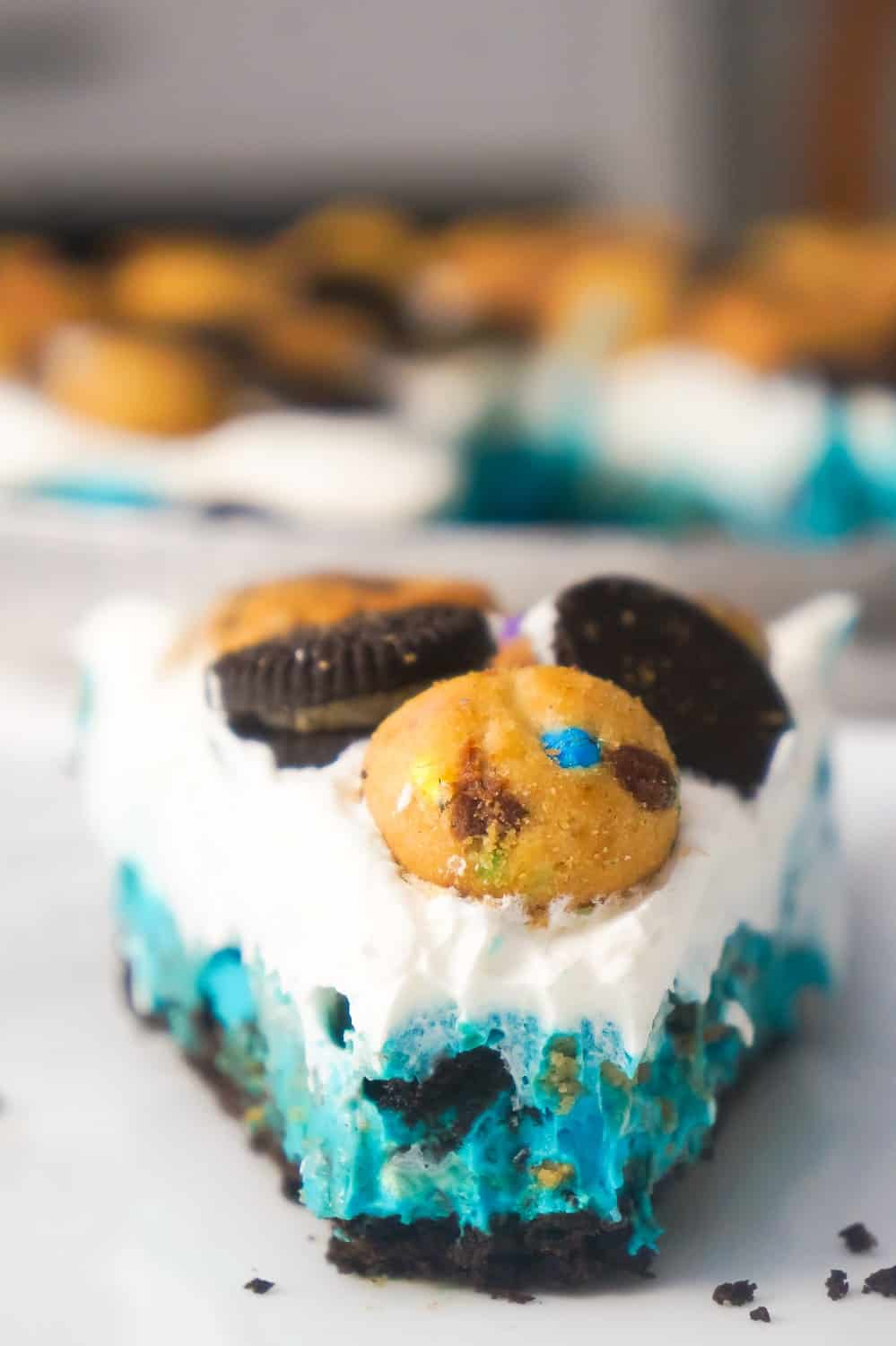 No Bake Cookie Monster Pie is an easy dessert recipe your kids will love. This colourful pie is made with instant pudding and Cool Whip in an Oreo crust and loaded with a variety of mini cookies.