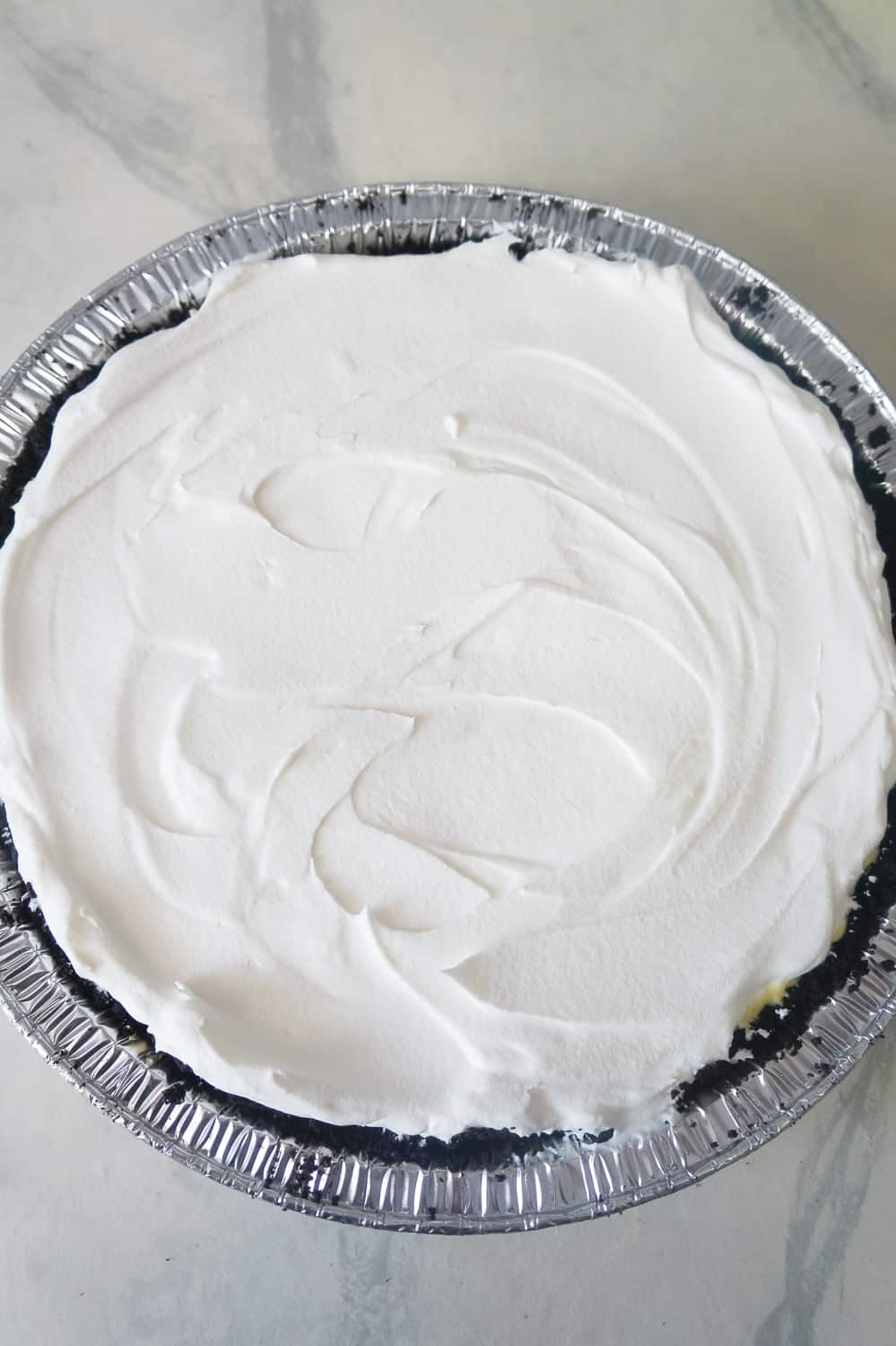 Cool Whip spread on top of no bake lemon pie