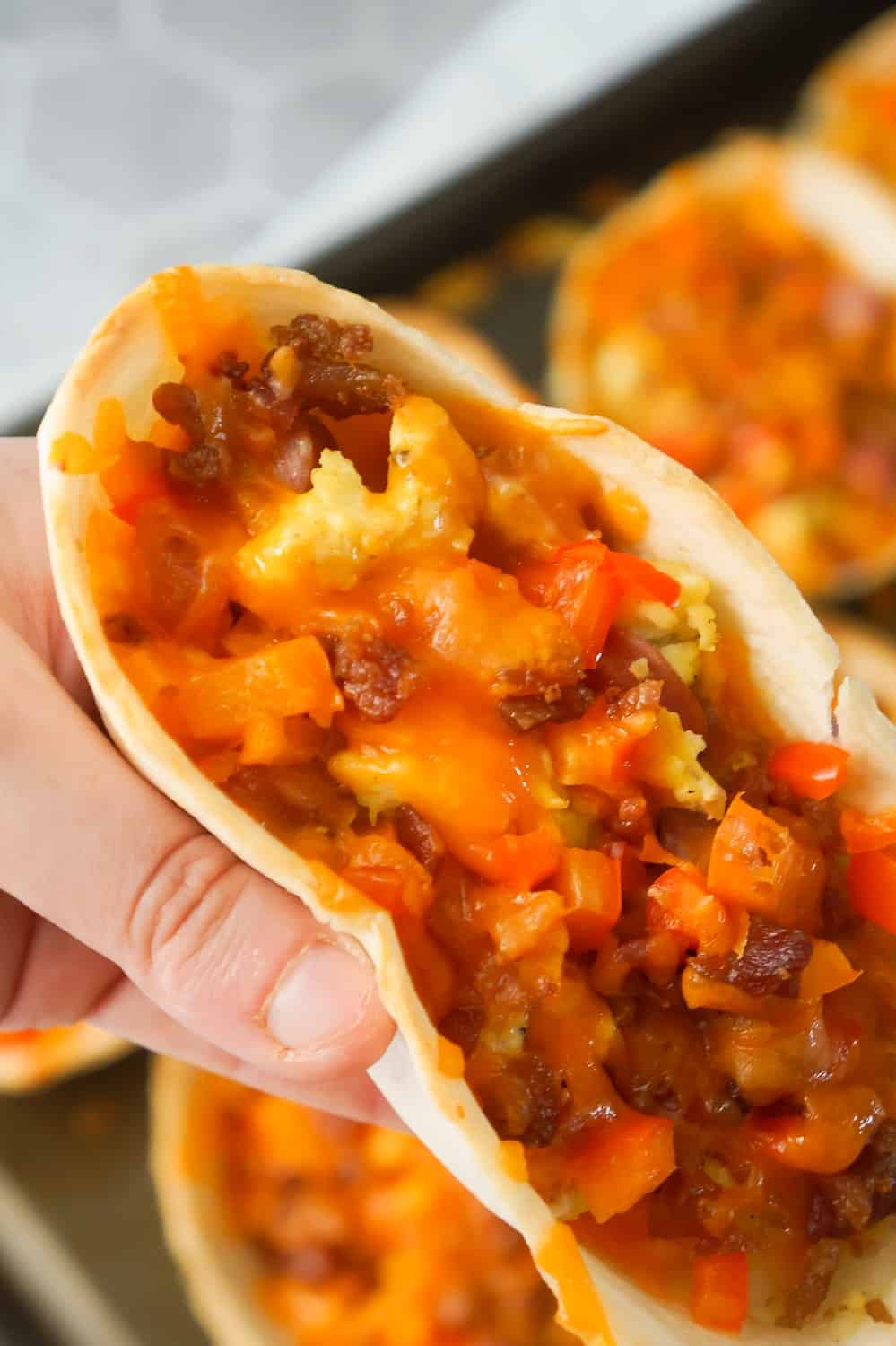 Sausage and Egg Breakfast Tacos are a fun and easy breakfast recipe. These breakfast tacos are made in Old El Paso tortilla bowls and loaded with eggs, maple breakfast sausage, cheddar cheese, sweet bell peppers and bacon.