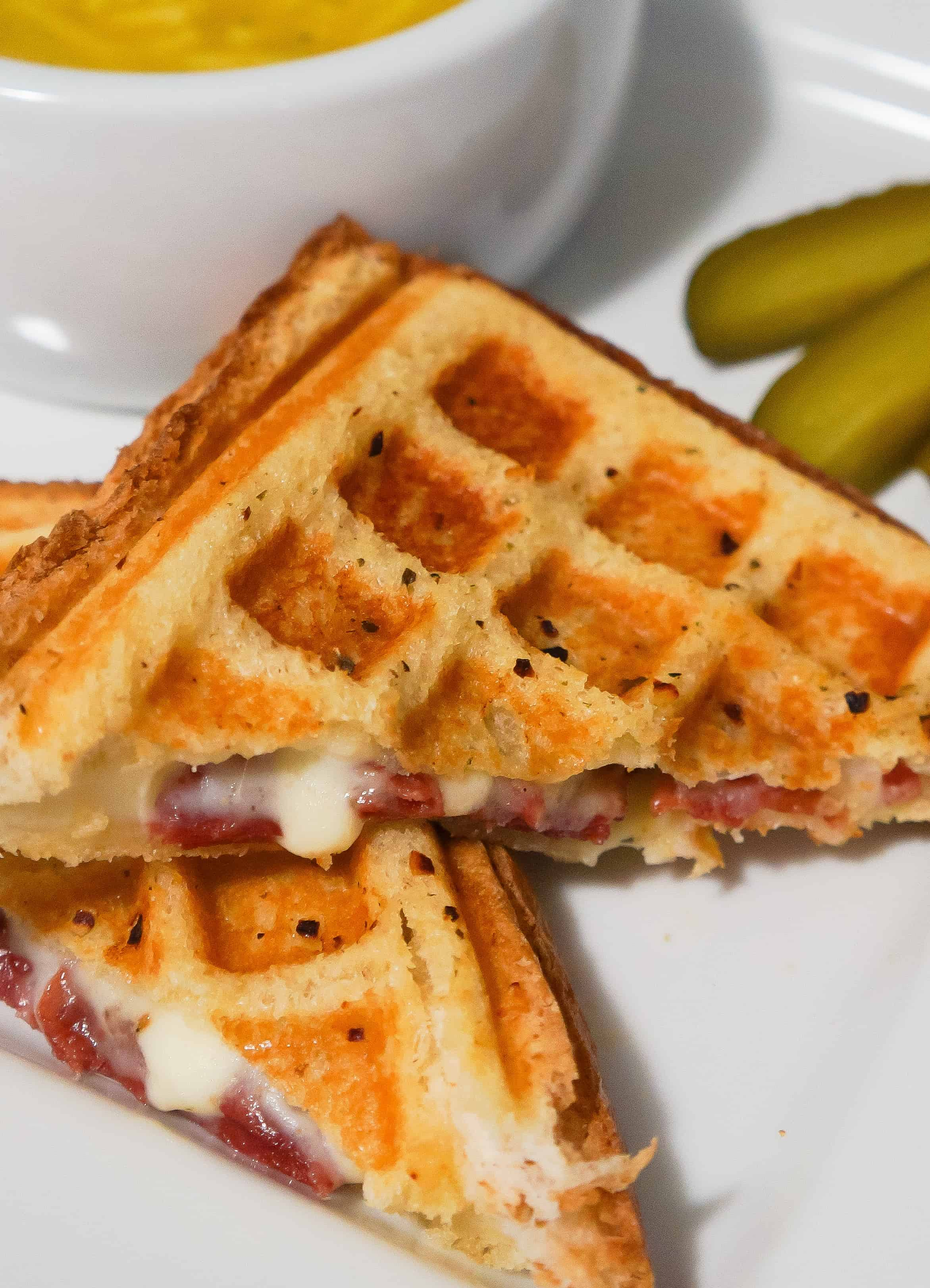 Grilled cheese sandwich with sauteed onions, corned beef and Havarti cheese cooked in a waffle maker. This waffled grilled cheese is perfect for lunch or a quick dinner.